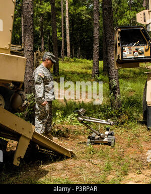 Massachusetts Army National Guard Col. Michael Finer, commander of the 79th Troop Command, observes an Explosive Ordnance Disposal (EOD) robot conducting reconnainsance during training at the Army's Joint Readiness Training Center, Fort Polk, La., Thursday,  July 28, 2016.  The National Guard Soldiers assigned to the 387th Explosive Ordnance Disposal Co., based in Cape Cod, Mass joined more than 5,000 Soldiers from other state Army National Guard units, active Army and Army Reserve troops as part of the 27th Infantry Brigade Combat Team task force, July 9-30, 2016. (U.S. Army National Guard ph - Stock Photo