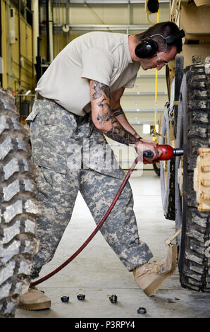 As part of his U.S. Army Reserve Annual Training participation in the 88th Regional Support Command's Operation Platinum Support mission, Pfc. Christian Kaplan with the 298th Support Maintenance Company out of Altoona, Pa., removes the lug nuts from a FMTV to remove the wheels for annual service and maintenance at the 88th RSC's Equipment Concentration Site 67 on Fort McCoy, July 28. Operation Platinum Support allows Army Reserve Soldiers in low-density supply and maintenance specialties to perform and gain proficiency in their technical skills while acting in direct support to the numerous ex - Stock Photo
