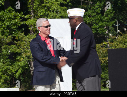 General (Ret) James F. Amos, left, 35th Commandant of the Marine Corps, and Forest E. Spencer, National President of the Montford Point Marine Association, greet each other during the Montford Point Marine Memorial dedication ceremony held at Jacksonville, N.C., July 29, 2016. The memorial was built in honor of the 20,000 African-Americans who attended training at Montford Point. (U.S. Marine Corps photo by Cpl. Laura Mercado) - Stock Photo