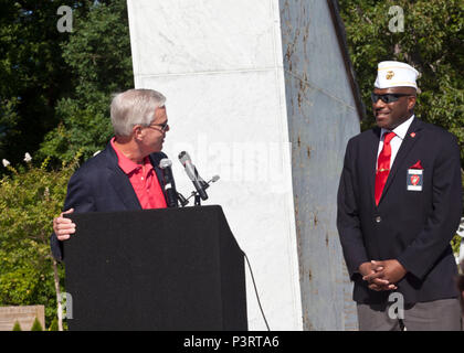 General (Ret) James F. Amos, left, 35th Commandant of the Marine Corps, addresses Mr. Forest E. Spencer, National President of the Montford Point Marine Association, during the Montford Point Marine Memorial dedication ceremony held at Jacksonville, N.C., July 29, 2016. The memorial was built in honor of the 20,000 African-Americans who attended training at Montford Point. (U.S. Marine Corps photo by Cpl. Laura Mercado) - Stock Photo