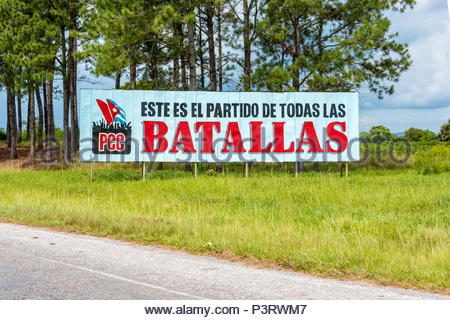 Cuban Communist Party propaganda sign or billboard in Pinar del Rio,Cuba. The sign reads: This is the party of all battles. - Stock Photo