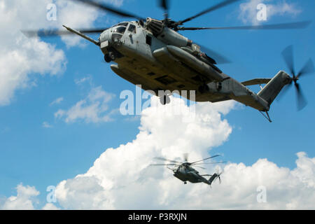 Two CH-53E Super Stallions with Marine Heavy Helicopter Squadron 461 prepare to land at Marine Corps Air Station New River, N.C., July 28, 2016 The CH-53E Super Stallion is the largest helicopter in the United States military, and able to carry a 26,000-pound Light Armored Vehicle, 16 tons of cargo, or enough combat-loaded Marines to lead an assault or humanitarian operation. The capabilities provided by the CH-53E strengthen the expeditionary capabilities of Marines Corps units and make this aircraft one of the most useful in the Marine Corps. HMH-461 is part of Marine Aircraft Group 29, 2nd  - Stock Photo