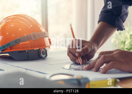 Architect or engineer using pencil and protractor working on blueprint, architectural concept - Stock Photo