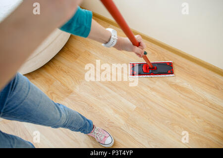 Photo of man with mop washer floor - Stock Photo