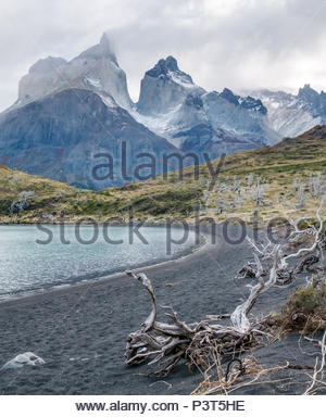 Black sandy lake, footpath to Cuernos lookout, Paine Horns, Torres del Paine National Park, Patagonia, Chile - Stock Photo