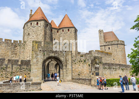 The medieval Cité of Carcassonne, French department of Aude, Occitanie Region, France. The Narbonne Gate. - Stock Photo