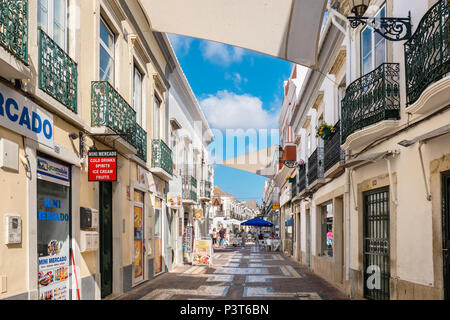 Shops and street cafe on a pedestrian area in old town. Faro, Portugal - Stock Photo