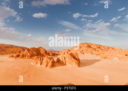 Sandy desert in Egypt at sunset - Stock Photo