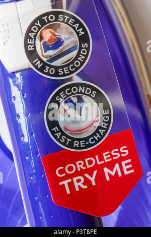 Cordless try me ready to steam in 30 seconds 5 seconds fast re-charge labels - Stock Photo