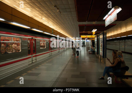 Prague, Czech Republic, 16. June 2018, prague metro people stand on platforms and awaiting entry into the wagon - Stock Photo