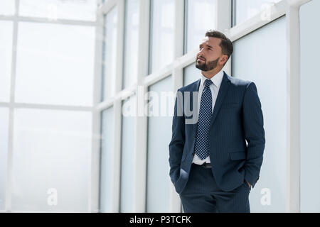 dreaming of a businessman standing in new office - Stock Photo