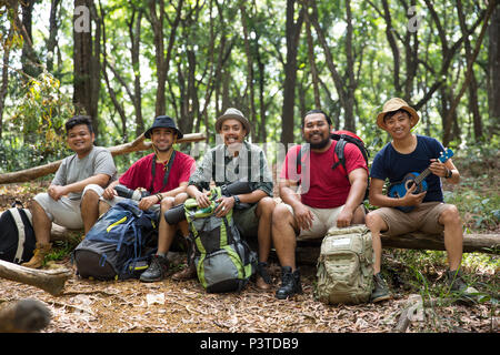 young friends hiking together - Stock Photo