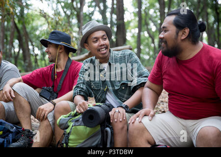 people hiker sitting and talking after hiking - Stock Photo