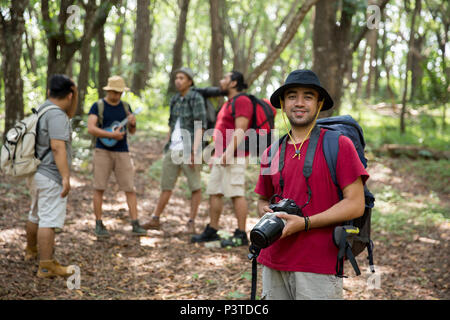 hiker with backpack holding camera - Stock Photo