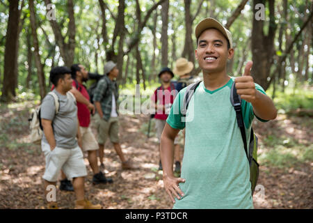 male hiker thumb up - Stock Photo