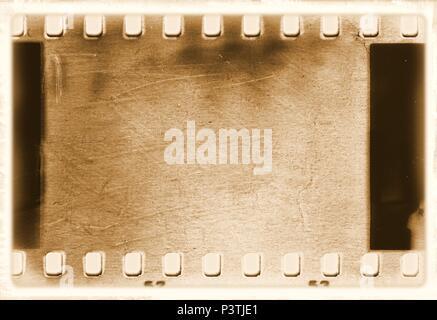 Vintage film strip frame in sepia tones. - Stock Photo