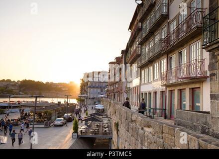 Busy Douro River waterfront in Barrio La Ribeira, Porto, Porto Region, Portugal - Stock Photo