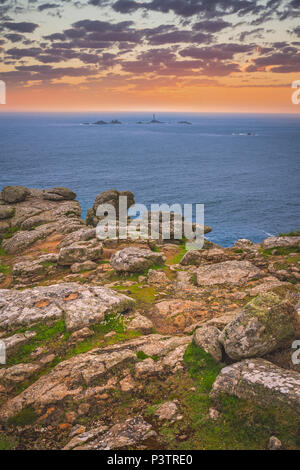 Sunset over the coast  in the Lands End - the most westerly point of England which is a popular tourist attraction, Penwith peninsula, Penzance, Cornw - Stock Photo