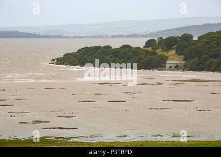 Jenny Brown's Point near Silverdale viewed from Warton Crag as a high tide backed by winds from Storm Hector floods across saltmarshes on the edge of  - Stock Photo