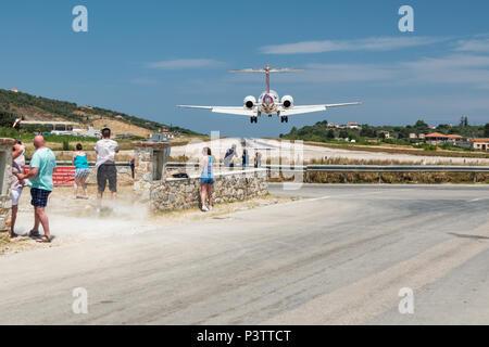 Passenger plane landing on Skiathos island Greece.
