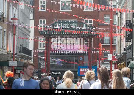 London UK. 19th June 2018. A large banner hangs form the gates of Chinatown  by the London Chinatown Chinese Association extends its congratulations to Prince Harry and Meghan Markle on their wedding day Credit: amer ghazzal/Alamy Live News - Stock Photo