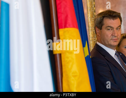 19 June 2018, Germany, Munich: Markus Soeder of the Christian Social Union (CSU), Premier of Bavaria, stands next to the Bavarian, German and European flag during the signing of the certificates of the 'Pakt fuer berufliche Weiterbildung 4.0' (lit. Pact for professional development 4.0). Photo: Peter Kneffel/dpa - Stock Photo