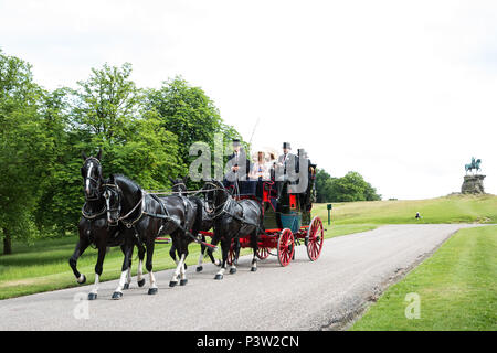 Windsor, UK. 19th June, 2018. Horse drawn carriages carry smartly attired racegoers back along the Long Walk in Windsor Great Park towards Windsor Castle at the end of the first day of Royal Ascot. Credit: Mark Kerrison/Alamy Live News - Stock Photo