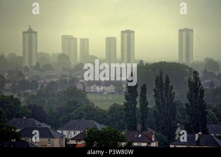 Glasgow, Scotland, UK 20th June. UK Weather: Midsummer approaches and autumnal wet foggy cold weather as only the greens of Knightswood golf course are totally visible in front of the Scotstoun towers while the city is invisible under the fog and rain in the distance, Gerard Ferry/Alamy news Credit: gerard ferry/Alamy Live News - Stock Photo