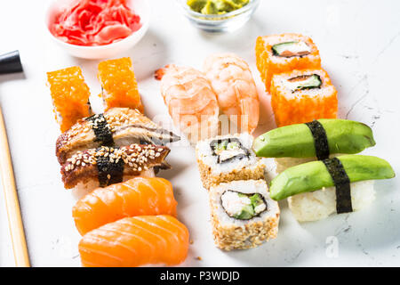 Sushi and sushi roll set on white background. Traditional asian food. - Stock Photo