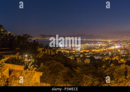 Nightly view over the city from the Boulevard des Pins - Stock Photo