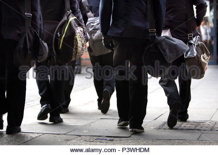 Embargoed to 0001 Wednesday June 20 File photo dated 26/01/12 of school pupils. According to the Commons Justice Committee, MPs have accused the Government of failing society in its approach to young adult offenders. - Stock Photo
