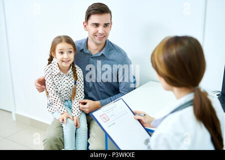 Father and daughter at doctor appointment - Stock Photo