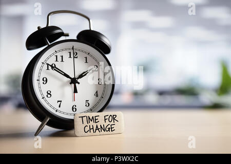 Time for change or action concept message with alarm clock on desk in office - Stock Photo