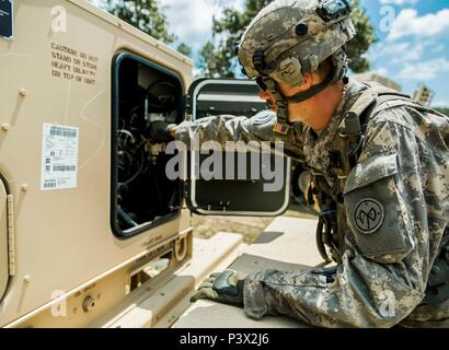 U.S. Army Sgt. Adam Lamb, a generator mechanic assigned to Echo Company, 427th Brigade Support Battalion, New York Army National Guard, works on a generator at the Joint Readiness Training Center, Ft. Polk, La., July 26, 2016. Almost 80 Soldiers from the Staten Island-based 145th Maintenance Company will be training at the Joint Readiness training Center in May, July and August in support of units from the Alabama and South Carolina Army National Guards.    U.S. Army National Guard photo by Sgt. Harley Jelis) - Stock Photo