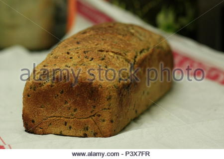 homemade sourdough bread being baked in a home kitchen resting cooling off - Stock Photo