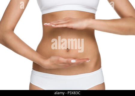 Pregnancy or diet concept, female hands protecting the stomach isolated on white background - Stock Photo