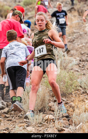 Female athlete Ruby Brown competes in a foot race and climb up 'S' Mountain (Tenderfoot Mountain) during the annual Fibark Festival; Salida; Colorado; - Stock Photo