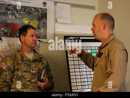 Twinsburg, Ohio. – Col. Frederic A. Drummond, left, Army colonel with JTF-Shield, meets with Marine Lt. Col. Shaun T. Fitzpatrick, right, executive officer of Chemical Biological Incident Response Force, CBIRF, and mission commander for Initial Response Force B with CBIRF, discuss plans in preparation for the Republican National Convention, RNC, in Cleveland, July 20, 2016.  CBIRF's Marines and sailors worked alongside federal and local agencies to provide chemical, biological, radiological, nuclear and high-yield explosives, CBRNE, response capability for the Republican and Democratic Nationa - Stock Photo