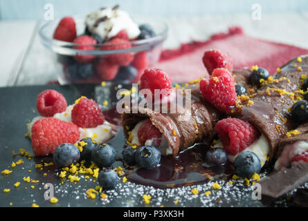 Gourmet Chocolate Crepes-Closeup food photos. Shot at various angles, overhead, vertical, horizontal. Sweet dessert or special breakfast. - Stock Photo