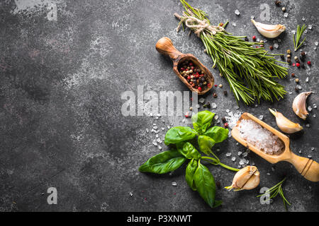Spices and herbs over black stone table. Food background. Top view, Copy space. - Stock Photo