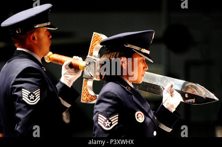 U.S. Air Force Honor Guard members Tech. Sgt. Juan Garcia and Staff Sgt. Annzen Salvador, both attached to Robins Air Force Base, Ga., carry the ceremonial sword to be put on display as part of the Order of the Sword in honor of Lt. Gen. James F. Jackson, former Chief of Air Force Reserve, at the Museum of Aviation in Warner Robins, Ga., July 13, 2016. The Order of the Sword was revised and updated from its European heritage by the Air Force enlisted in 1967 to recognize and honor senior officers with the rank of colonel or above, and civilian equivalents, for conspicuous and significant contr - Stock Photo