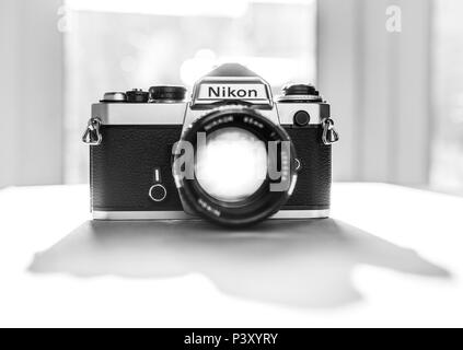 Nikon FE single lens reflex 35mm professional film camera, First launched in 1978 and remained in production until 1983. - Stock Photo