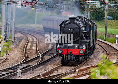 Winwick Cheshire United Kingdom.  18th June 2018. The world's most famous steam locomotive, LNER A3 Class 4-6-2 no 60103 Flying Scotsman seen crossing - Stock Photo