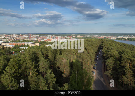City of Tampere, Finland, and lush trees at the Pyynikki ridge viewed from above on a sunny day in the summer. - Stock Photo