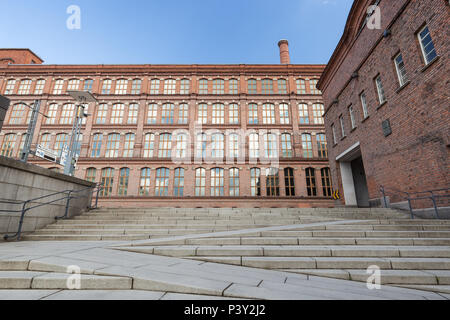 Stairs and old red brick industrial buildings in downtown Tampere, Finland on a sunny day. - Stock Photo