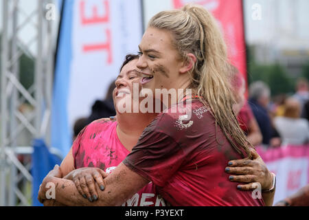 Ladies taking part in a 'Muddy 5k' fun run in aid of Cancer Research UK - Stock Photo