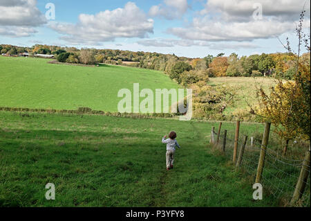 Reading, Berkshire, Chiltern hills. Young child playing in English countryside. - Stock Photo