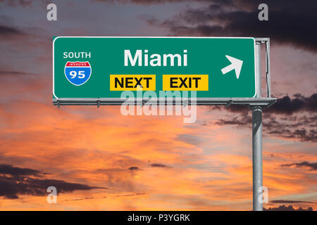 Miami Florida route 95 freeway next exit sign with sunset sky. - Stock Photo