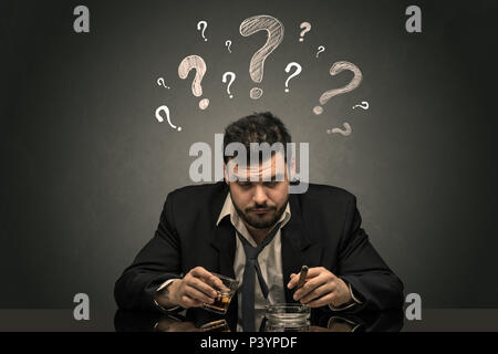 Young drunk disappointed man with question signs concept  - Stock Photo