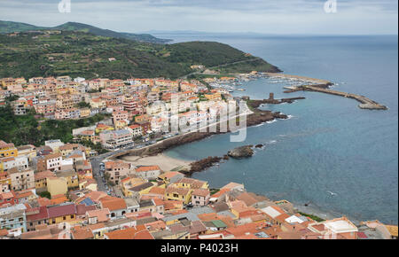 skyline and the houses and the harbour with old tower of castelsardo on sardinia island - Stock Photo